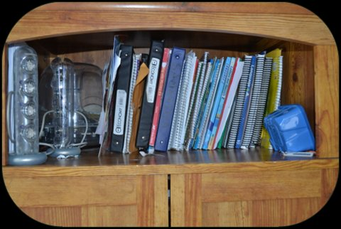 Our shelf of all books and notebooks used daily.